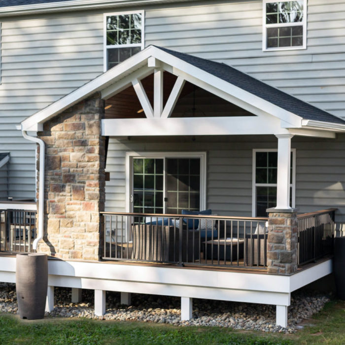 Composite deck with fireplace