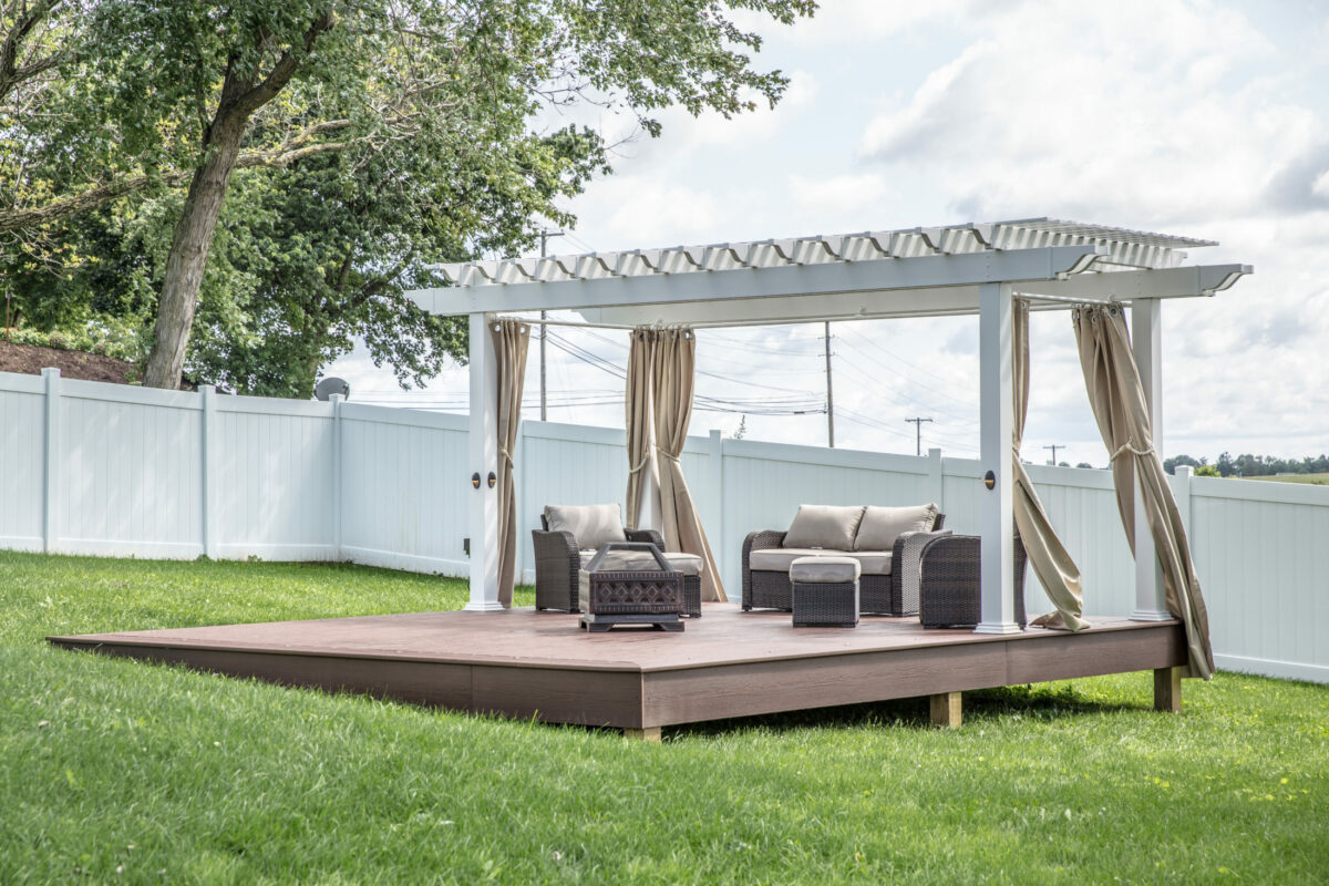 Detached deck with pergola in middle of backyard