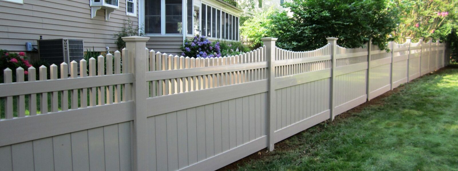 Vinyl privacy fence in back yard