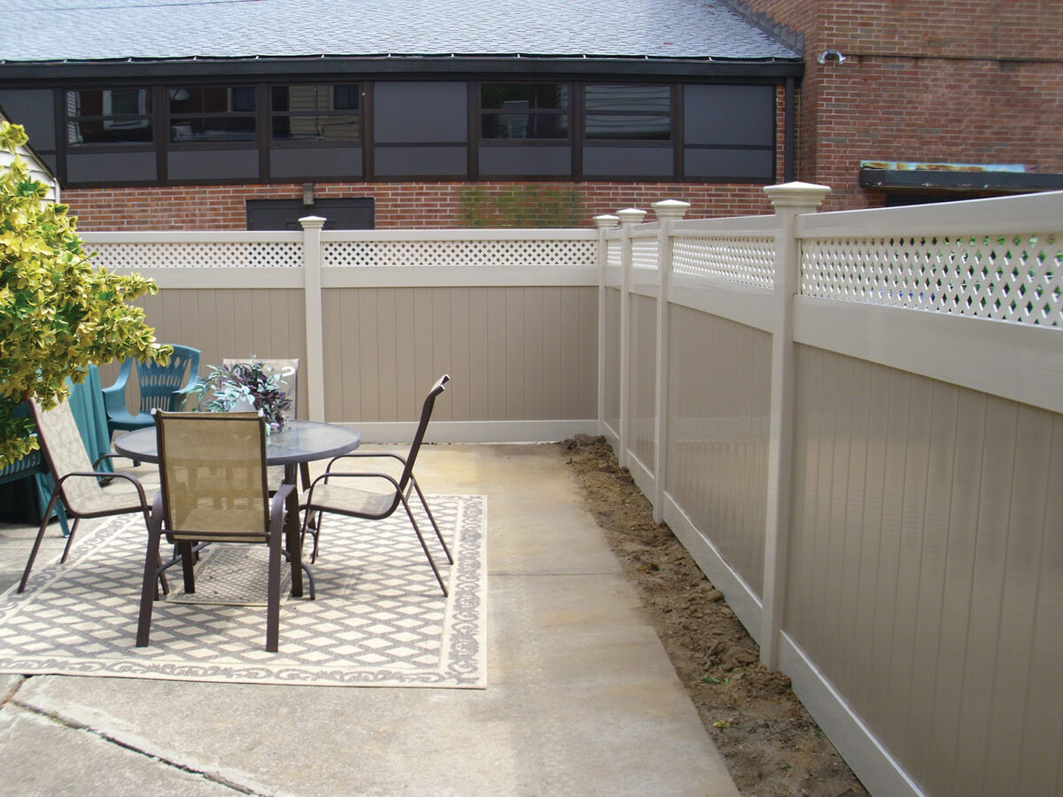 two tone vinyl privacy fence with lattice top