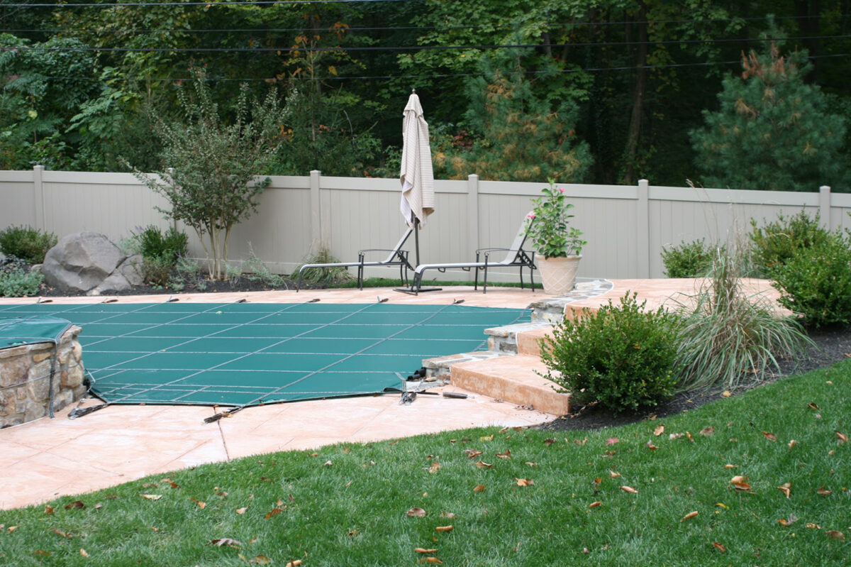 khaki colored vinyl privacy fence around swimming pool