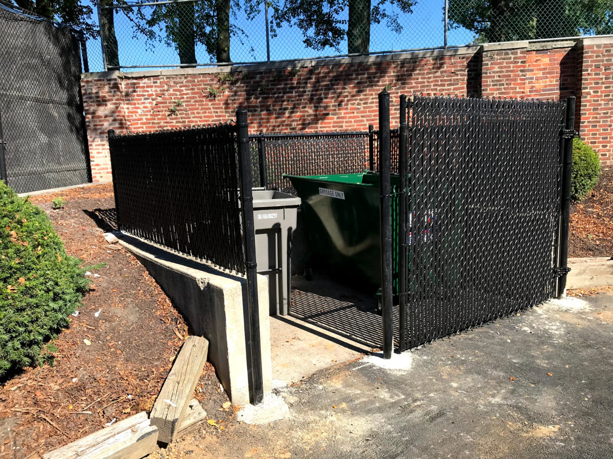 Chain link fence trash enclosure