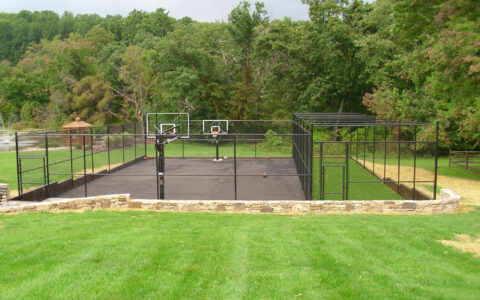 Chain link fence around sports court at a residence