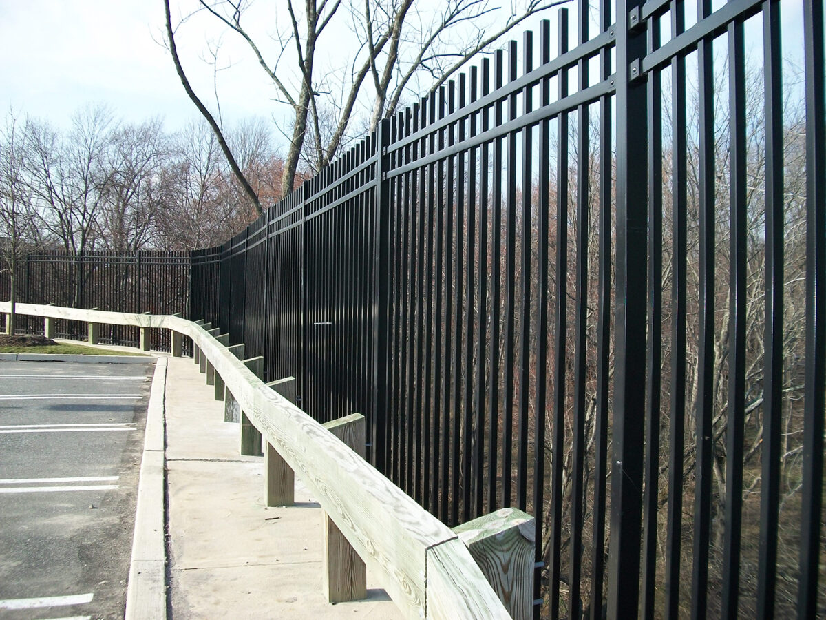 Decorative security fence behind guard rail