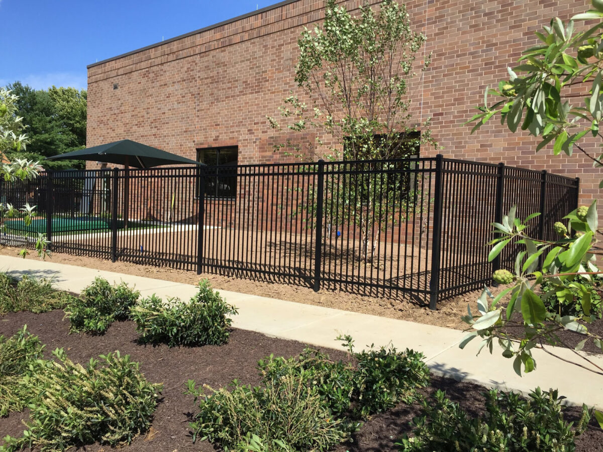 Black metal fence in commercial space