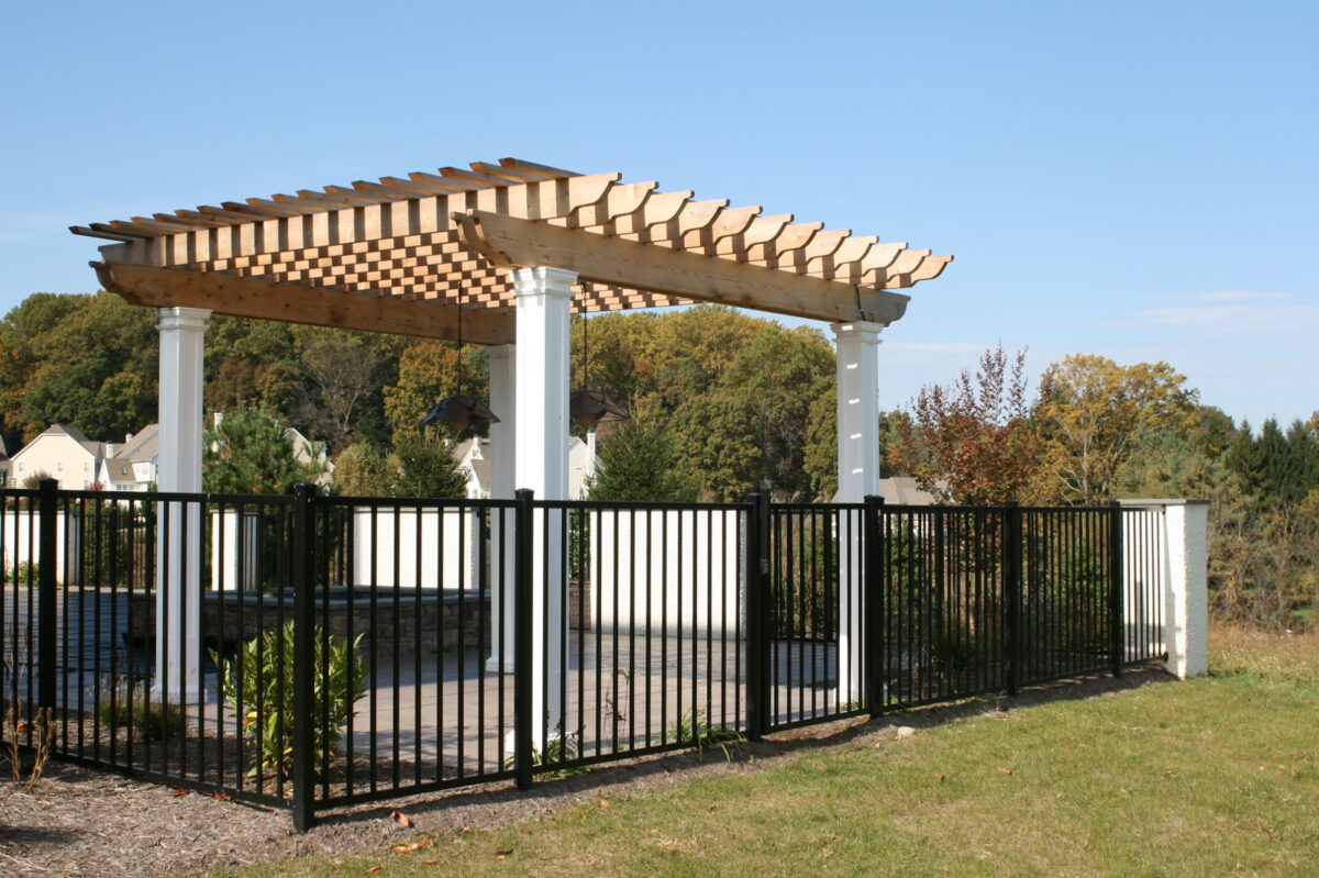 black ornamental metal fence around swimming pool
