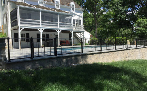 black ornamental fence around pool