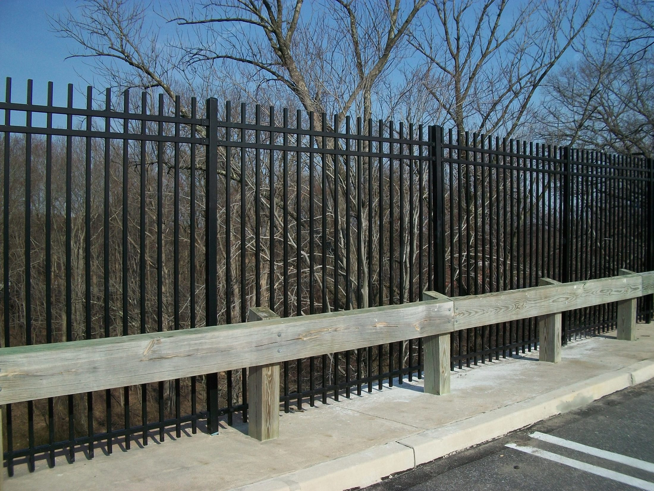 steel fence behind guard rail