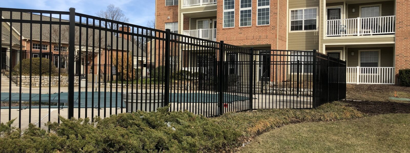 black commercial fence around pool