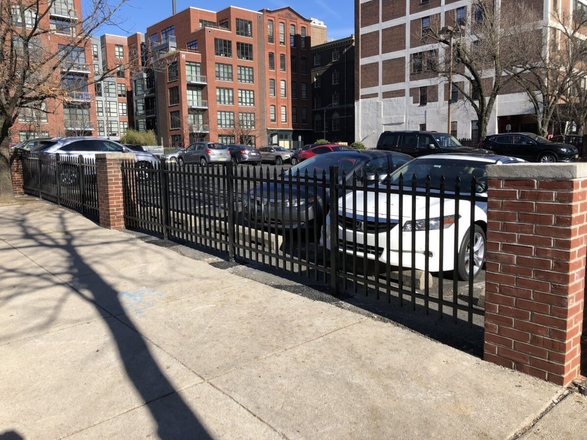 black commercial fence around pparking lot