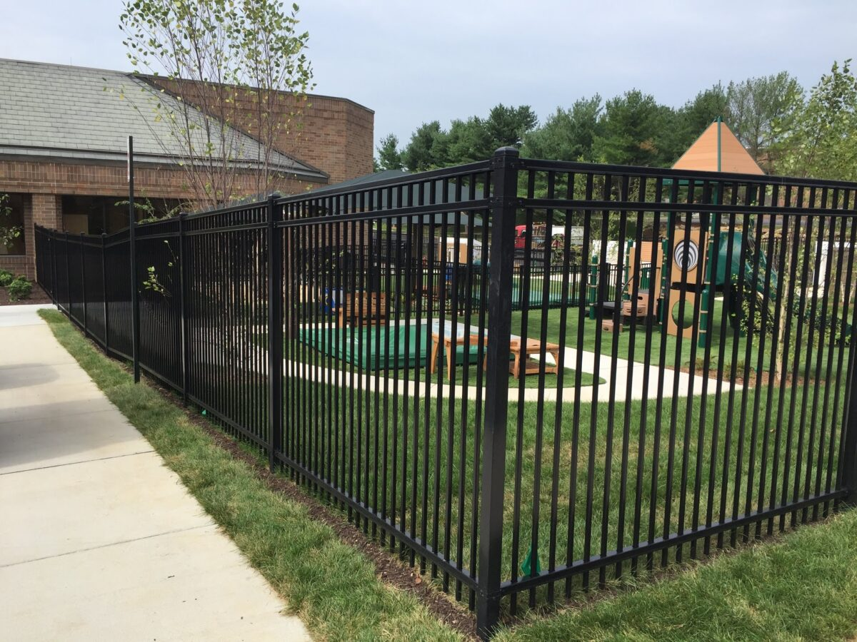 black commercial fence around playground