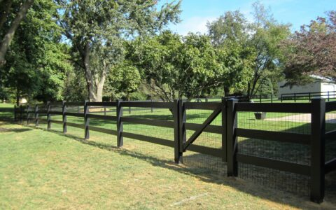 black vinyl rail fence with gate
