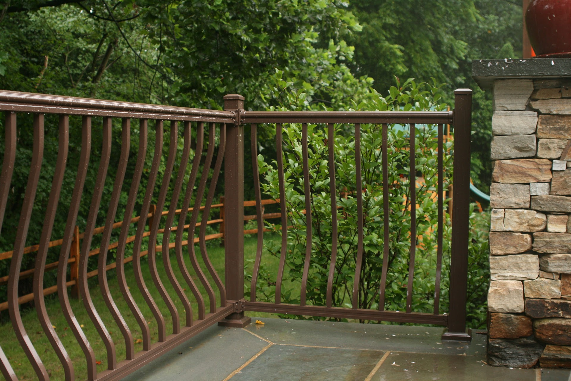 bronze railing on stone patio