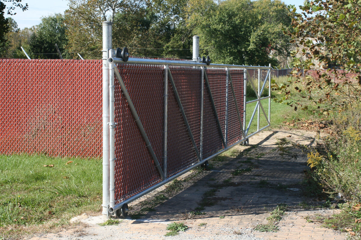 Chain link fence with sliding gate and privacy slats