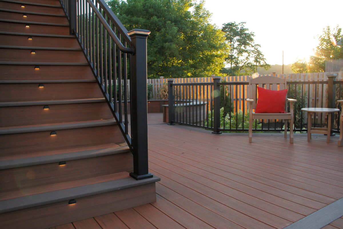 deck with railing and lights