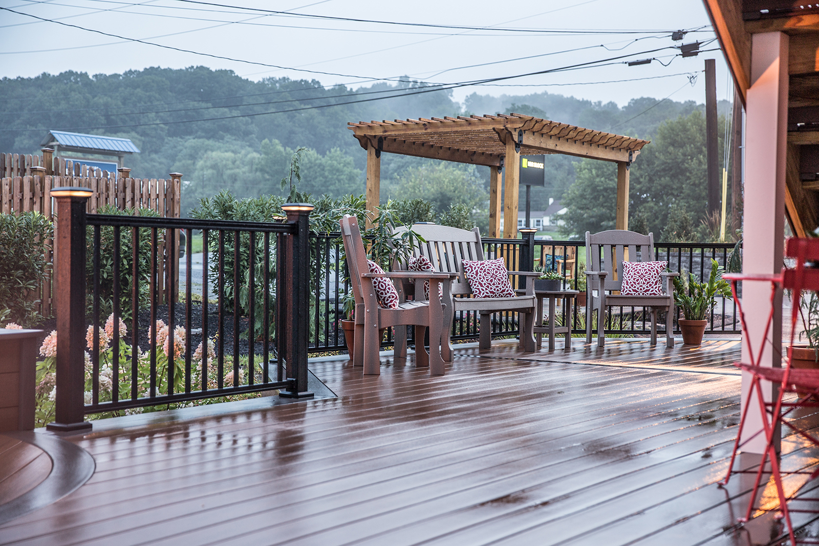 deck with lighted railing and furniture