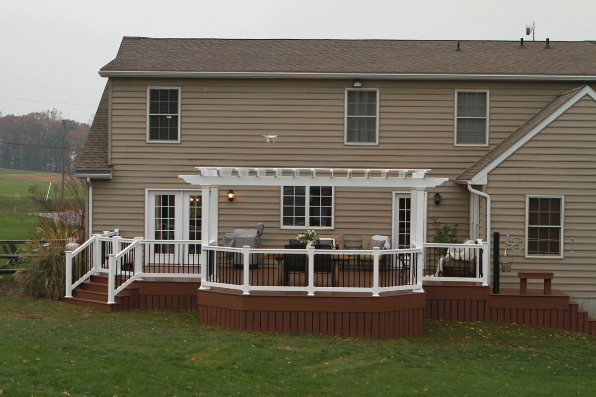 deck with pergola and railing
