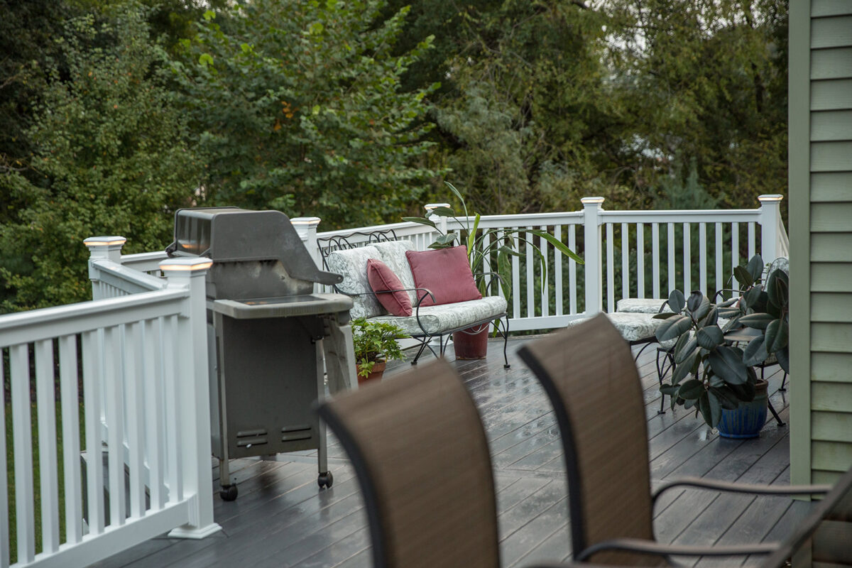 deck with vinyl railing and lighted post caps