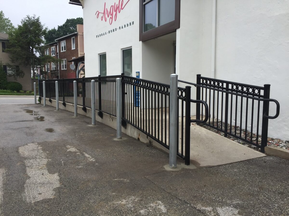 black railing on ramp with hand rail