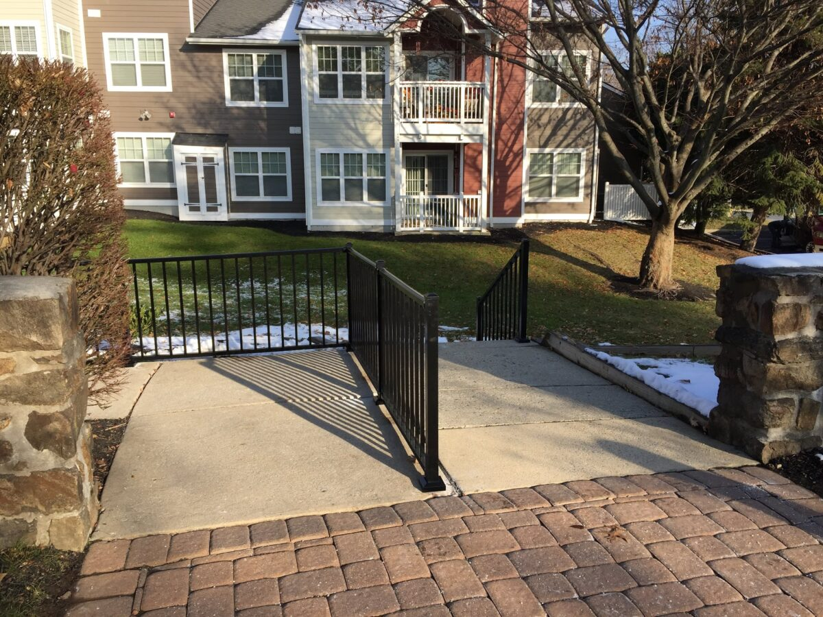 black railing on stairs and landing