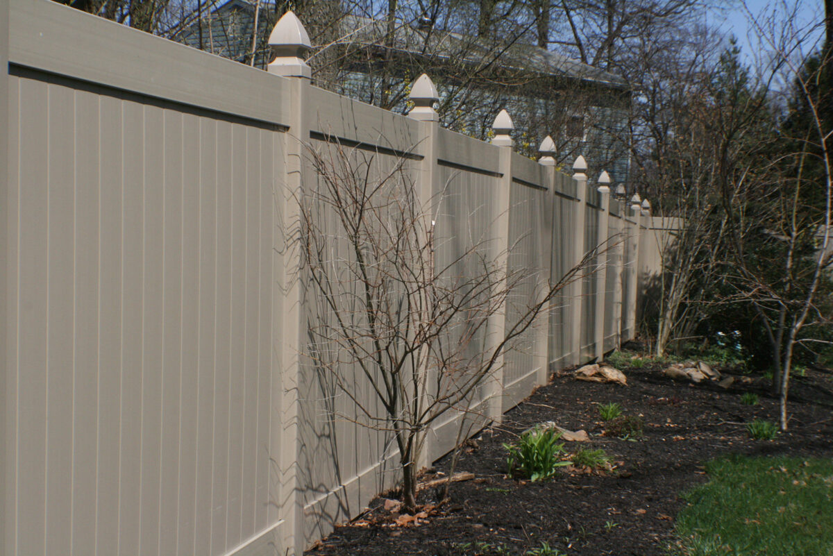 khaki privacy fence in back yard