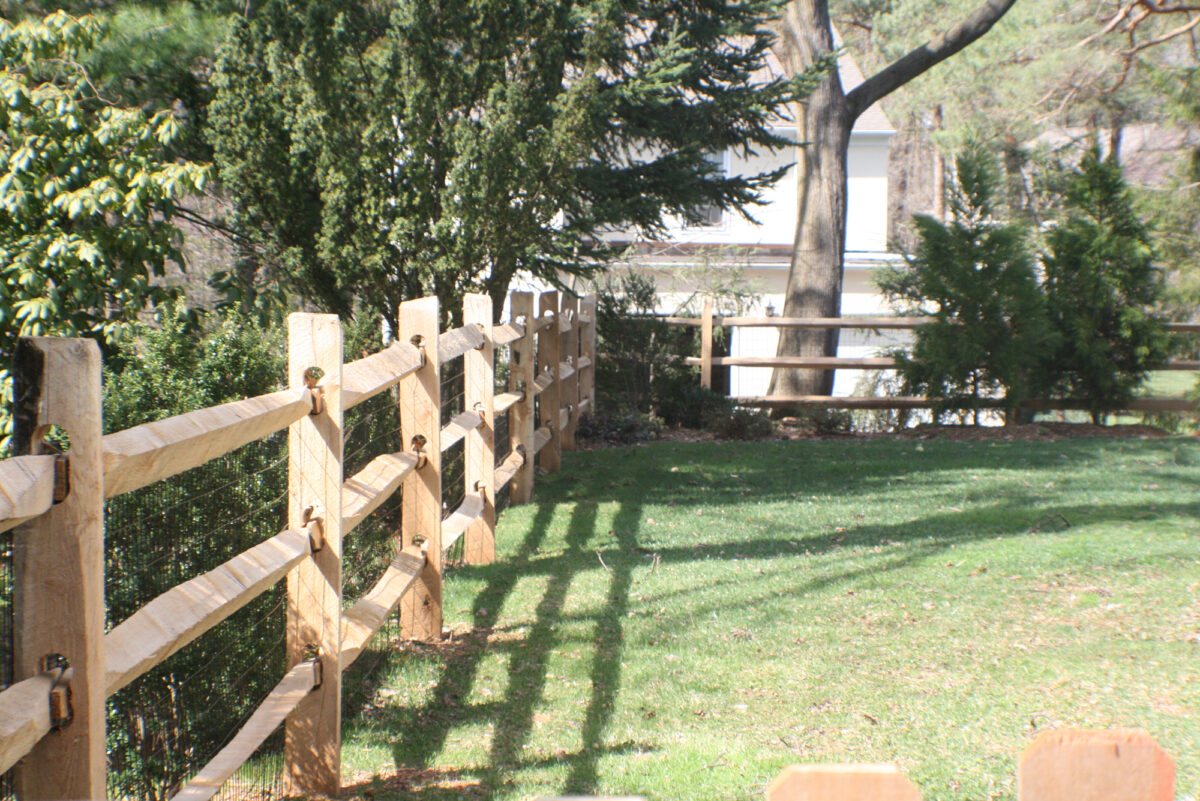 split rail fence with wire mesh