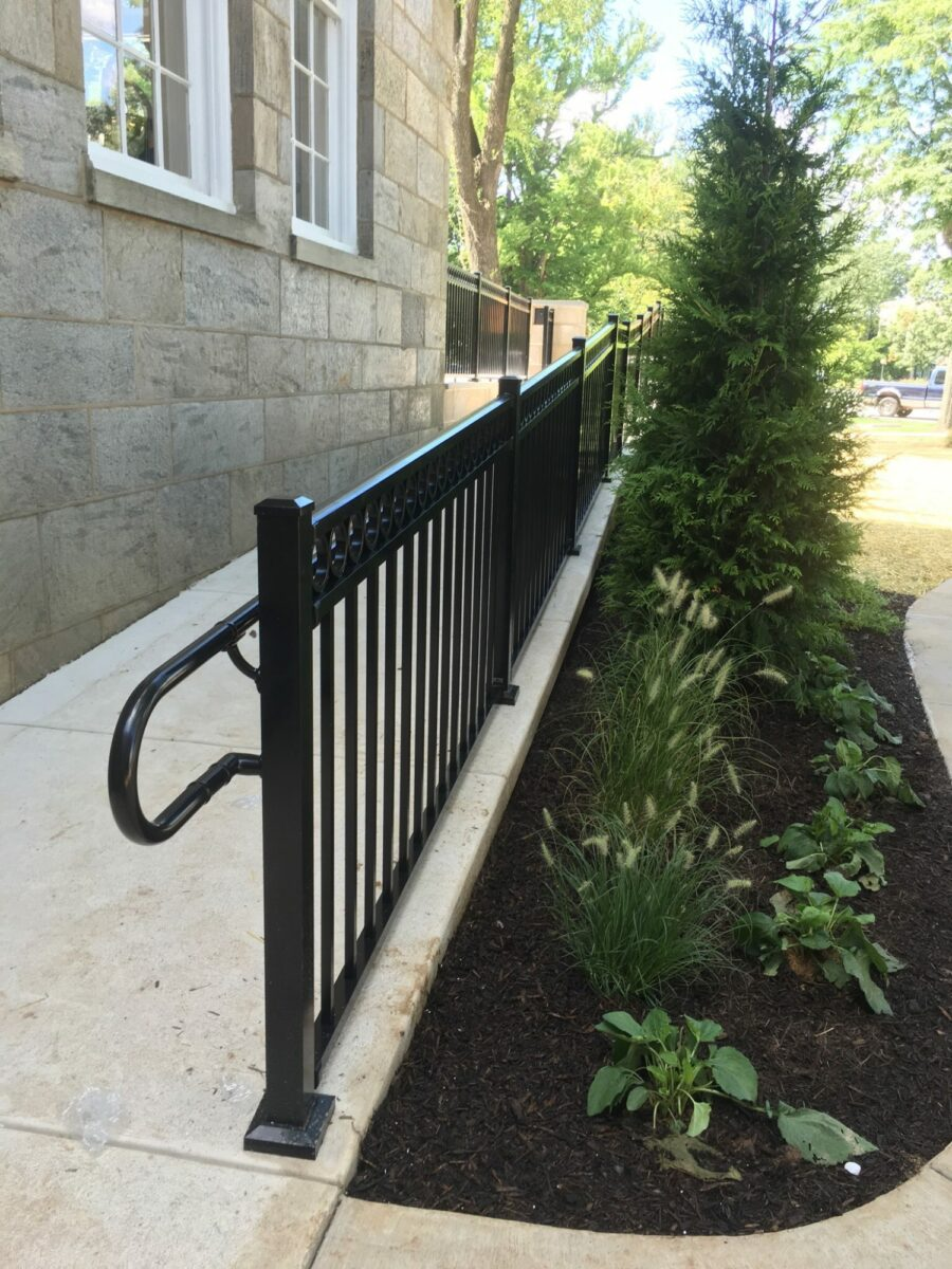 black railing with hand rail on ramp