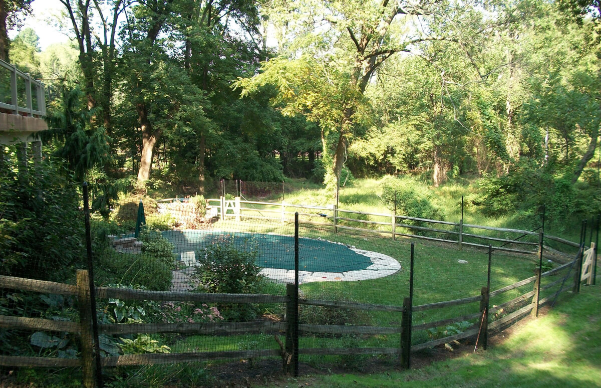 black deer fence around pool