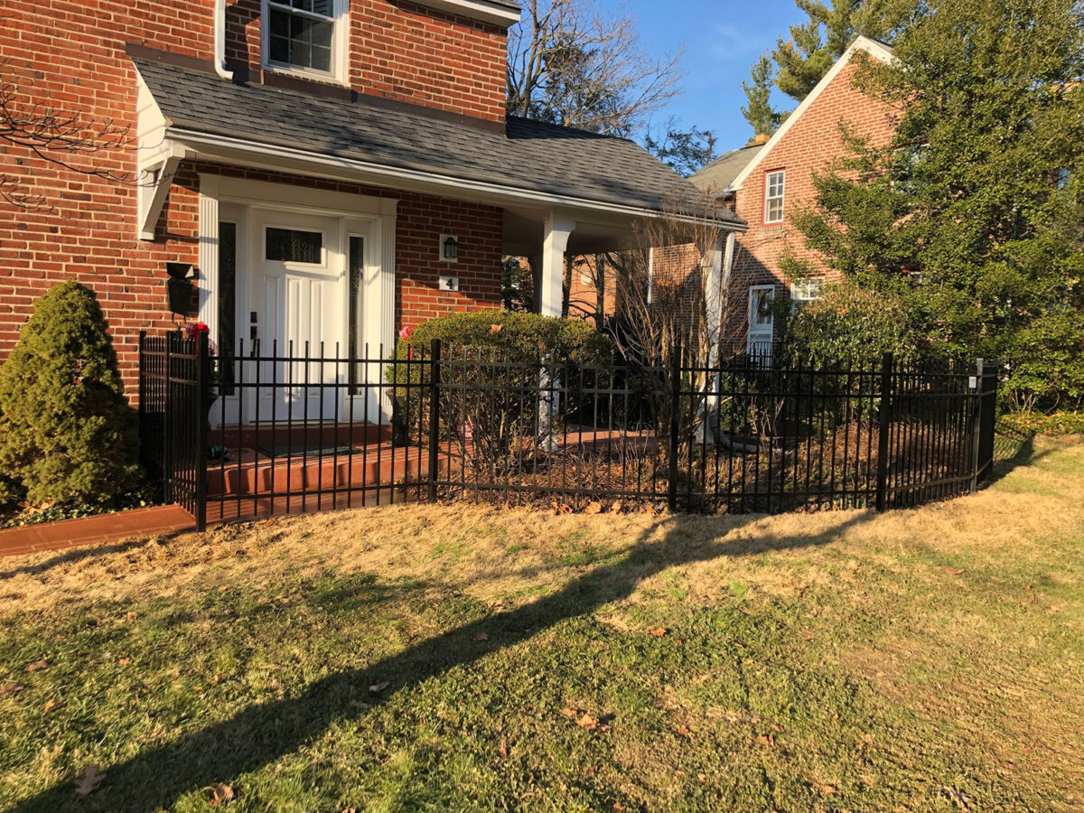 Ornamental aluminum fence with gate in yard