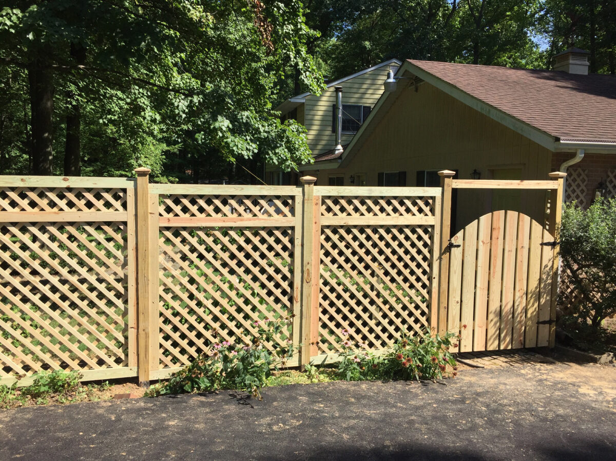 wood lattice fence with arched gate