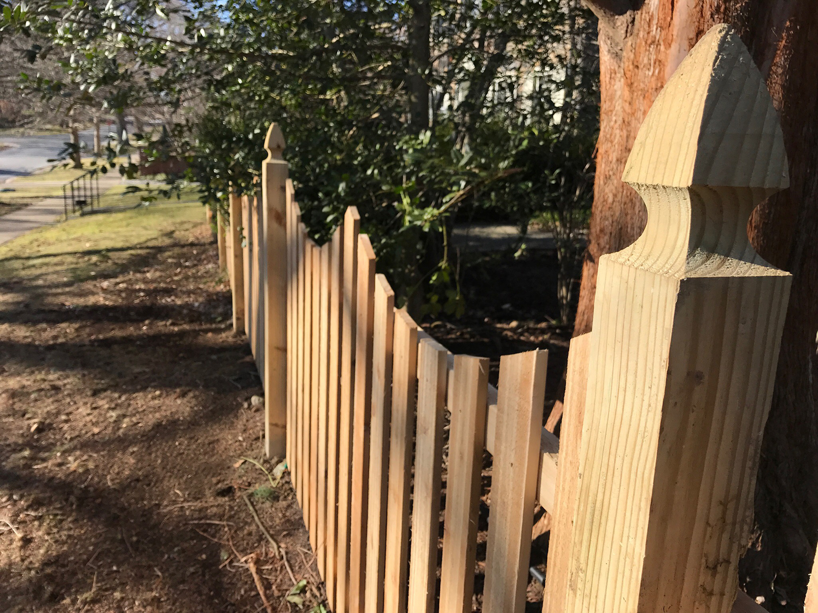 picket fence with french gothic posts