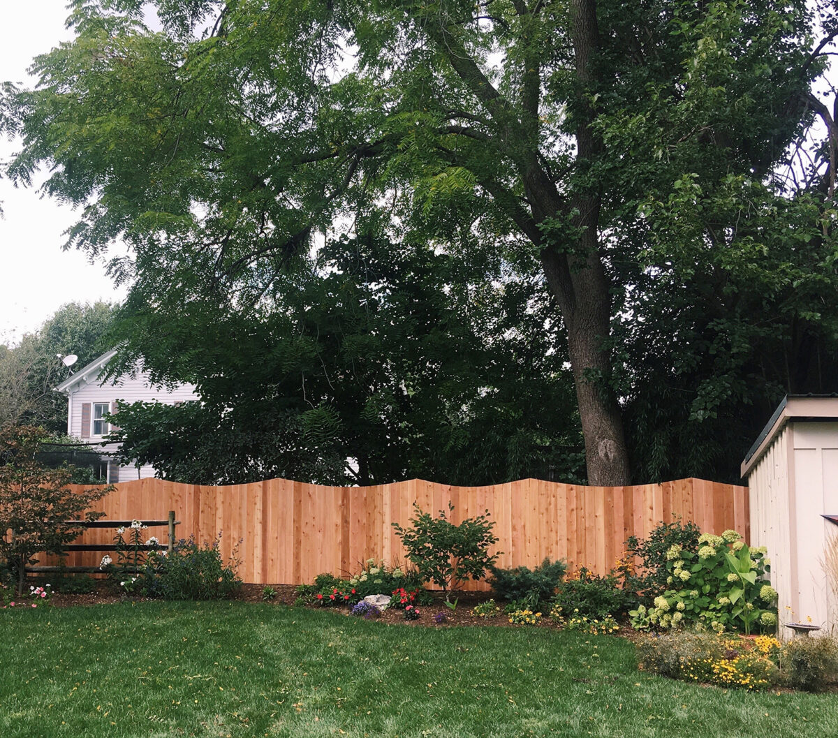 concaved wooden privacy fence
