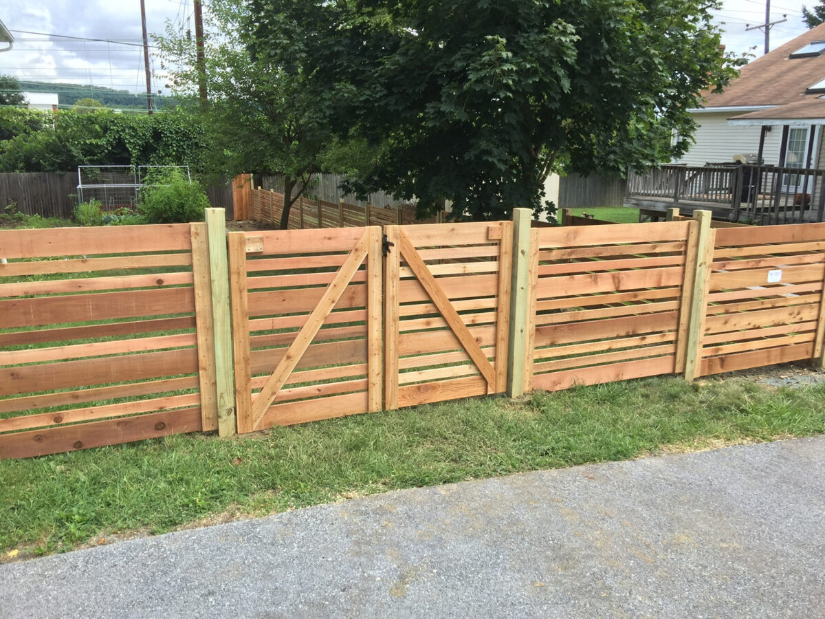 red cedar semi-private fence with double gates