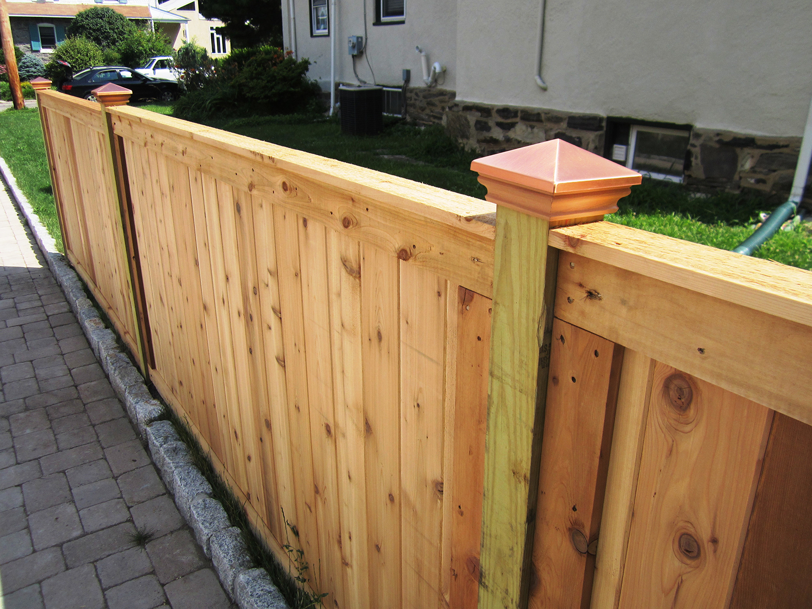 framed wooden privacy fence with post caps