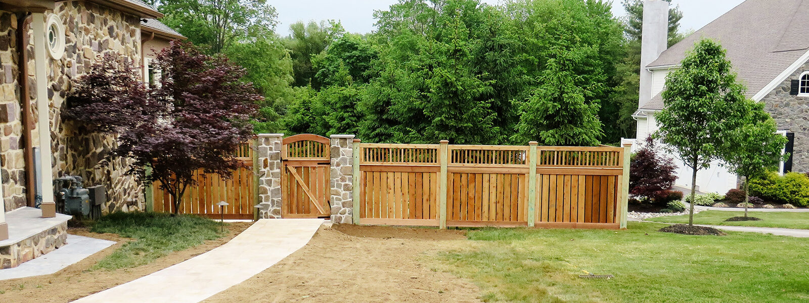 wooden fence with arched gate