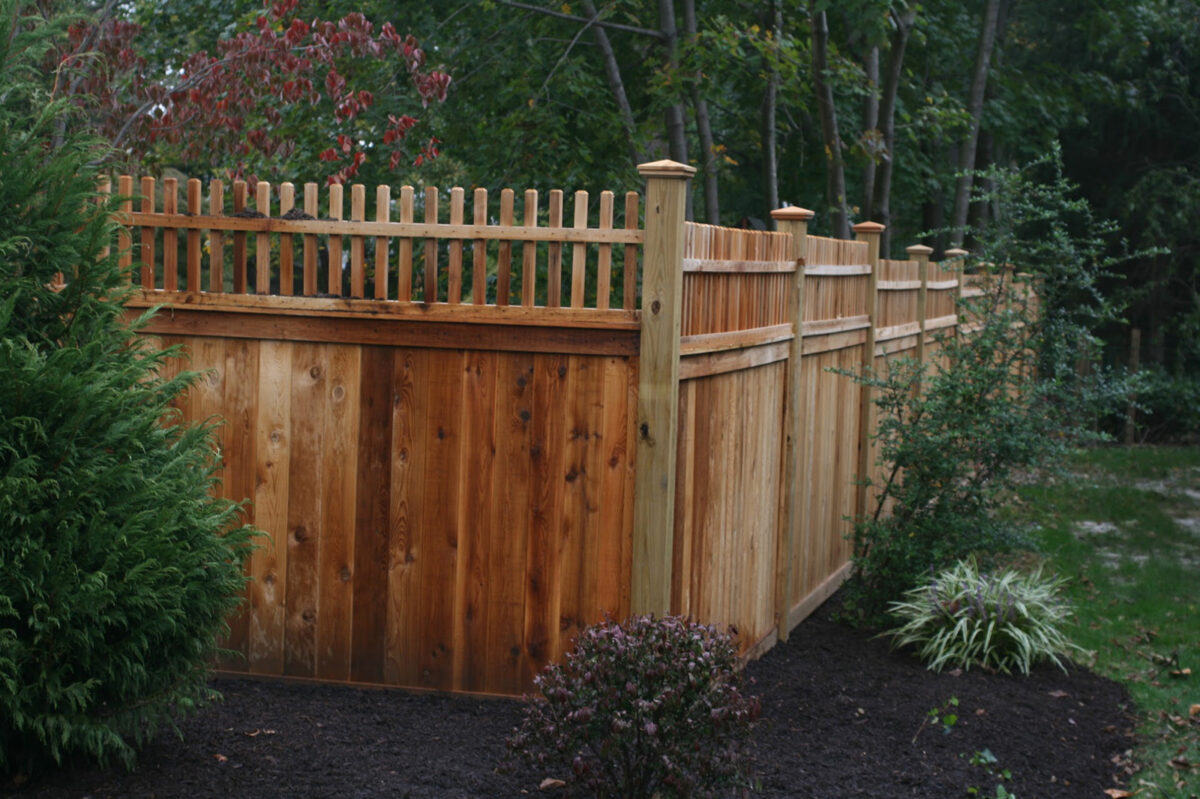 wooden privacy fence with post caps and decorative top