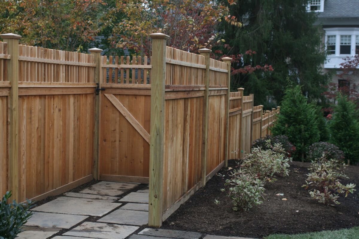 wooden privacy fence with decorative spindle top and walk gate