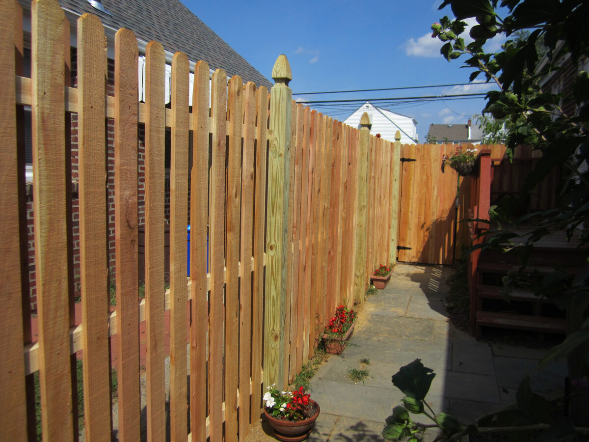 Shadowbox fence with french gothic posts