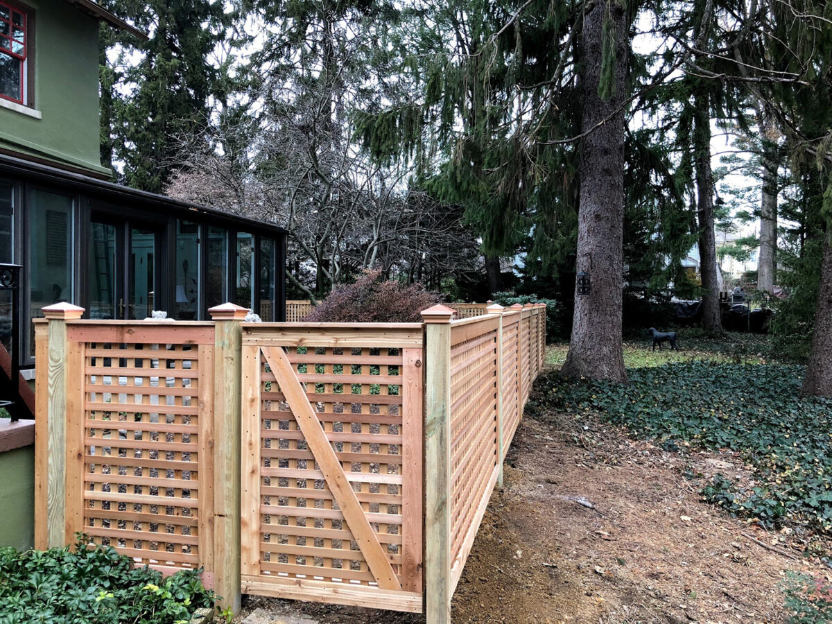 Framed red cedar fence in yard with gates