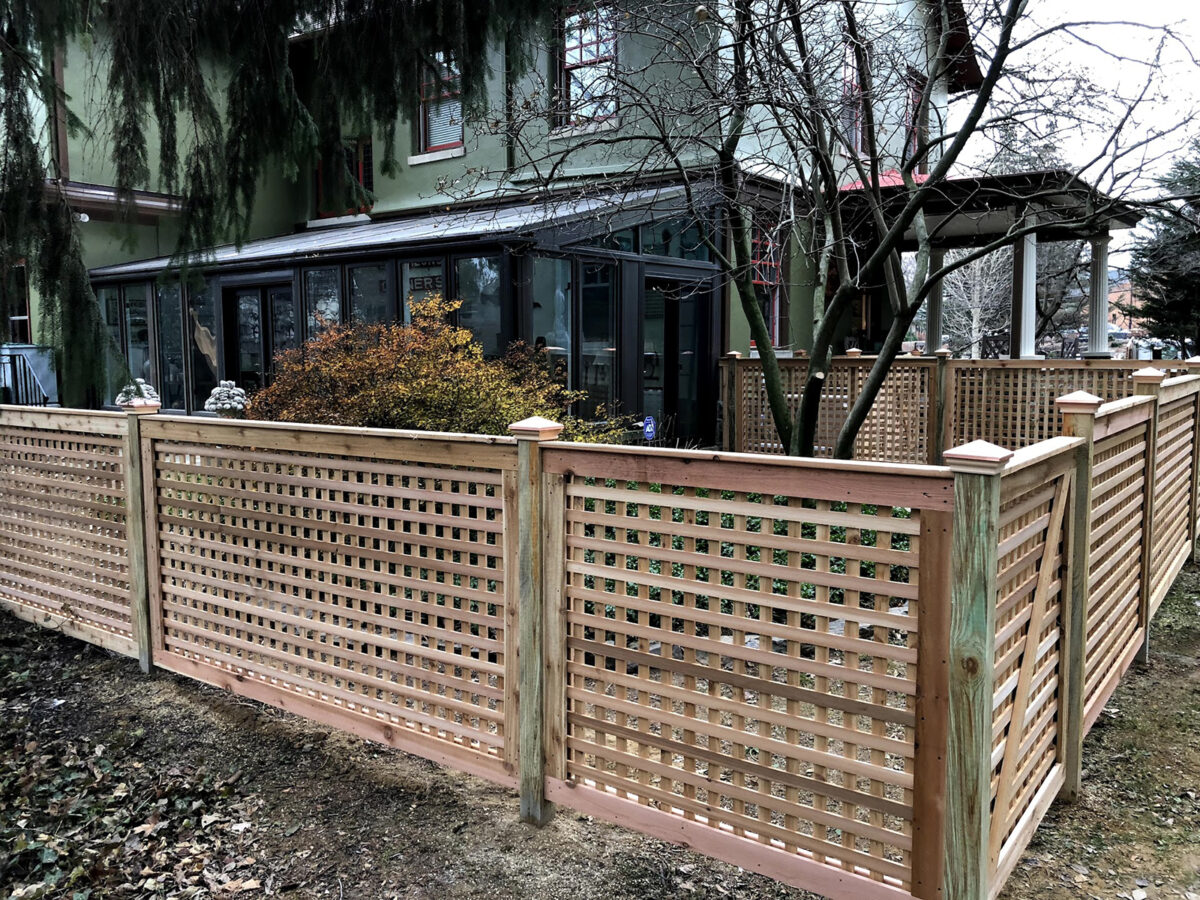 Framed red cedar fence in yard