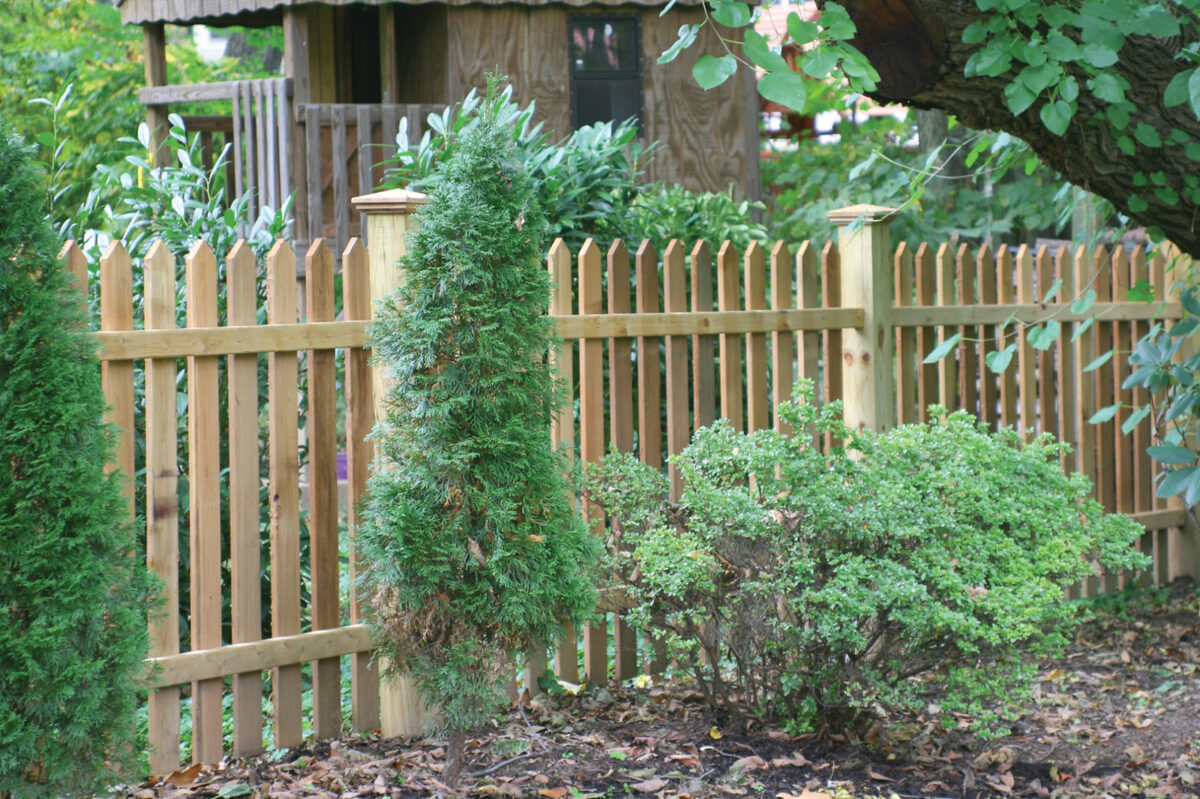 wood picket fence with post caps