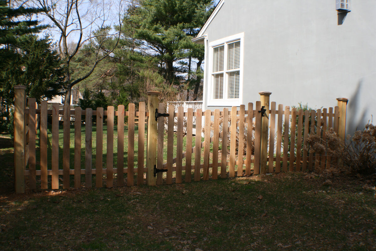 concaved wood picket fence with gate