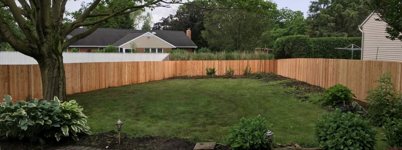 wood sounds abatement fence in yard