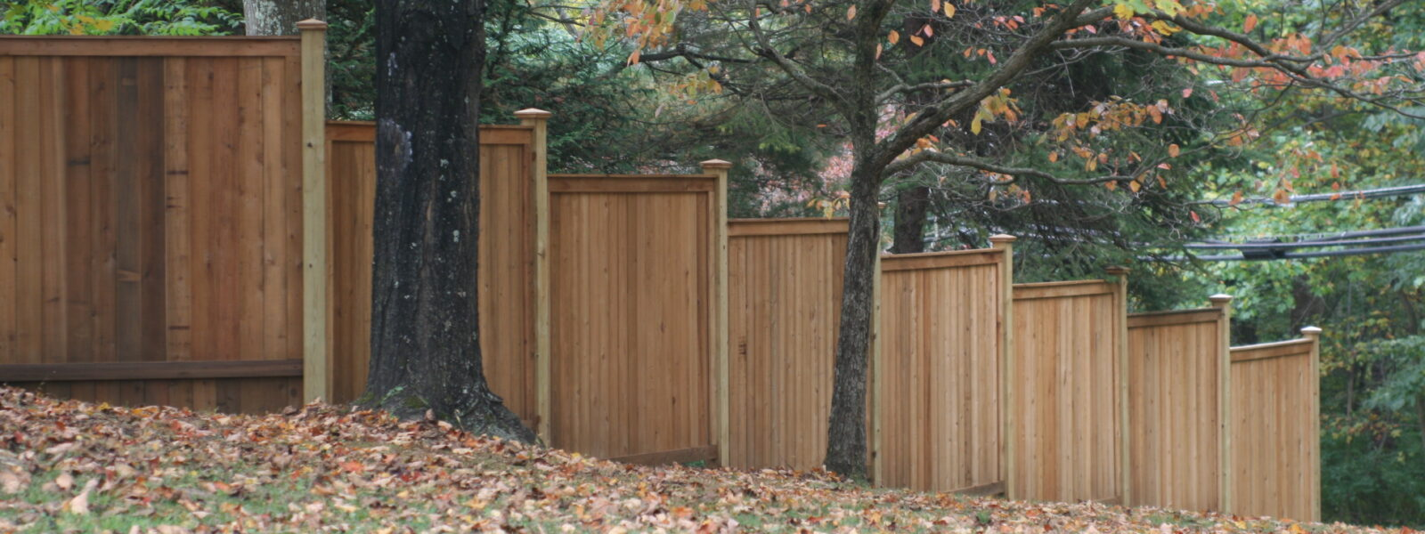 stepped wood sound abatement fence