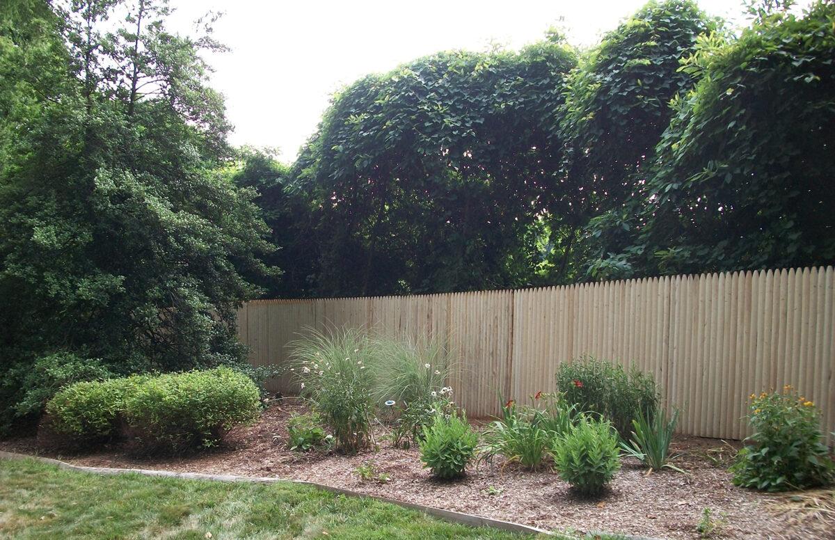 Stockade fence in yard