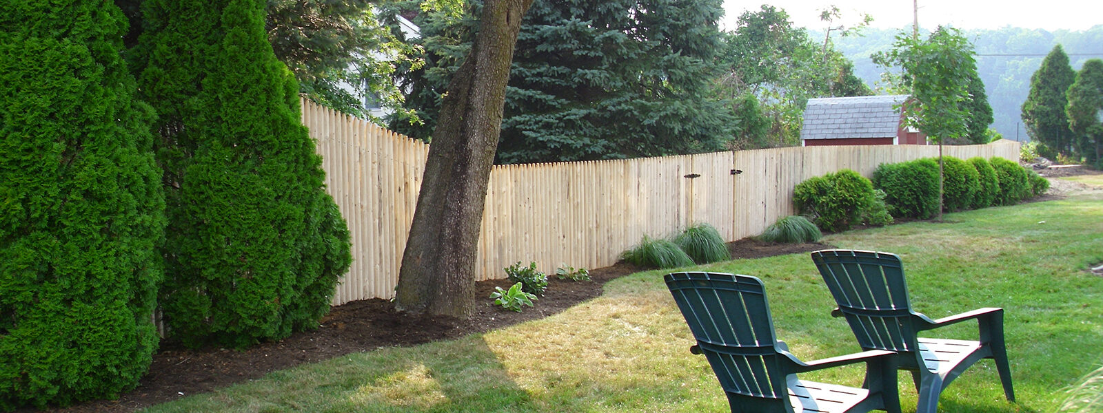 Stockade fence in yard with gate