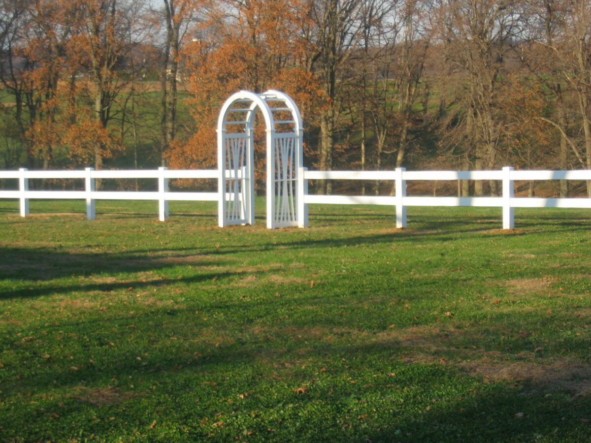 rail fence with arbor