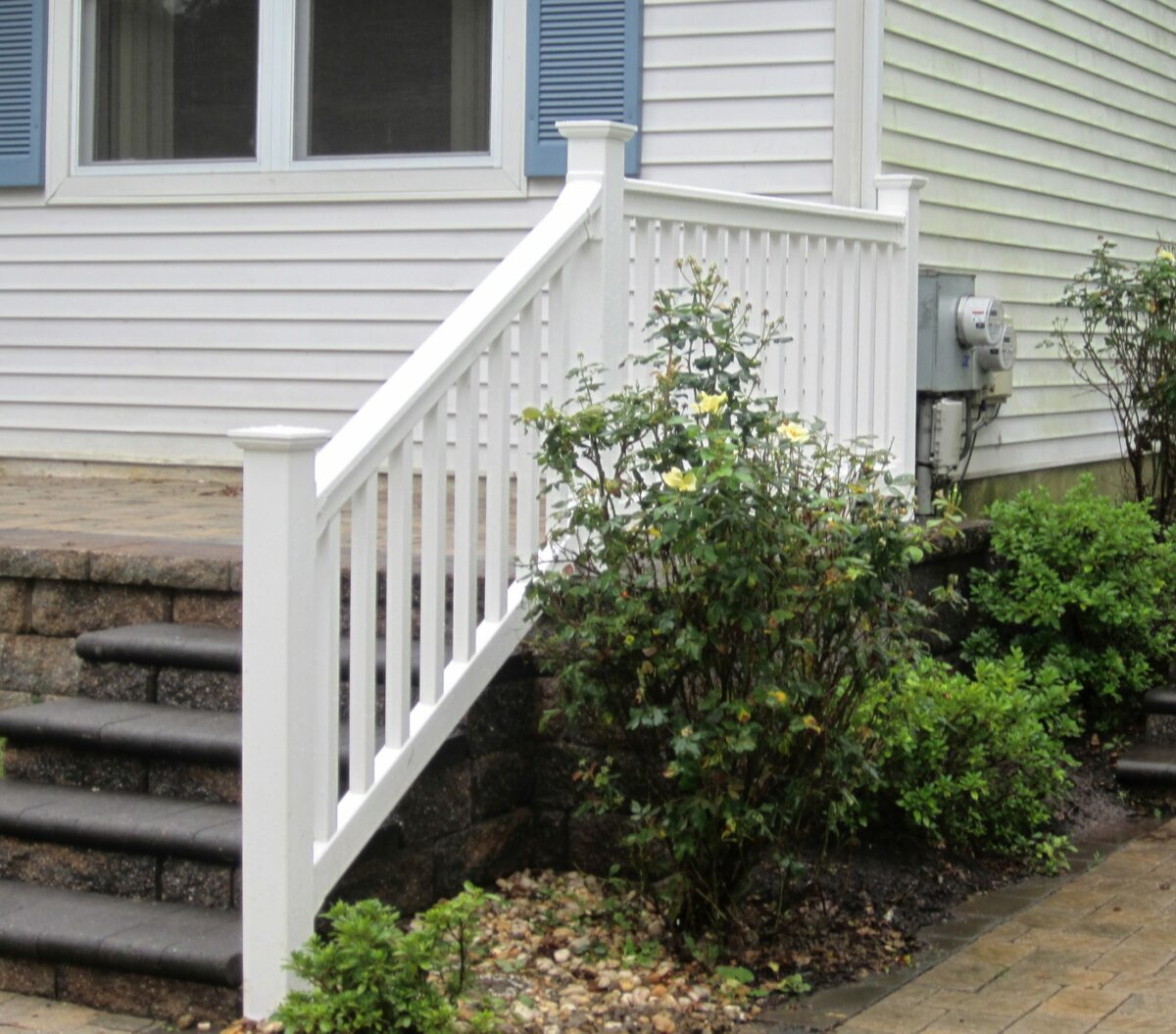 white vinyl railing on porch and stairs
