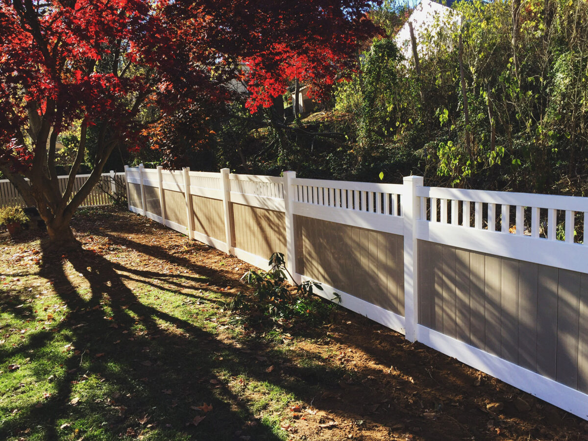 vinyl privacy fence in white and khaki colors