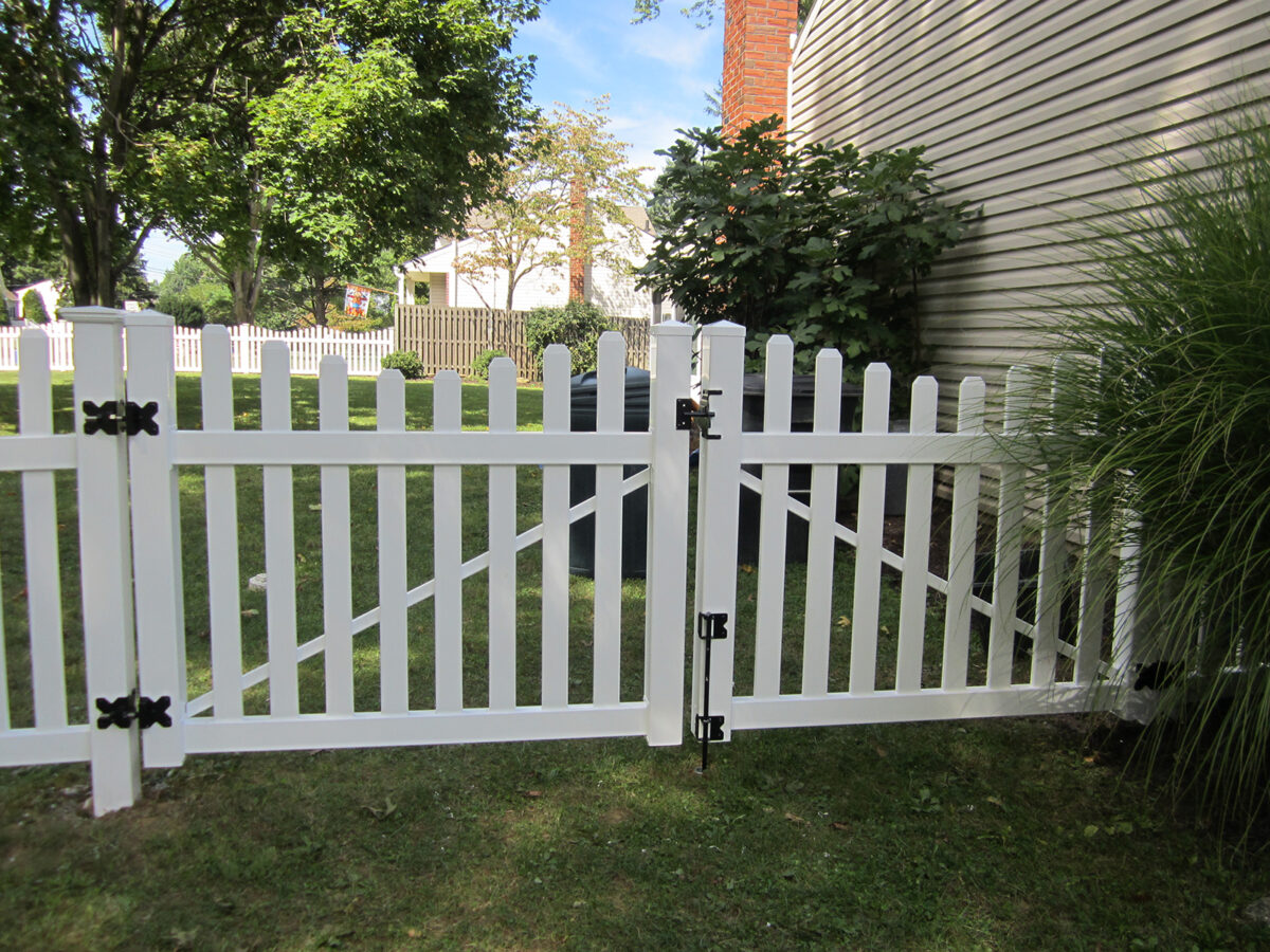 white vinyl picket fence with double gate